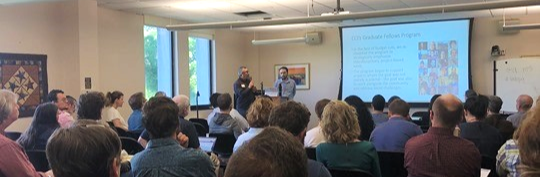 Javier and Christian address a packed room at the Humanities for the Public Good meeting