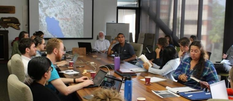 Ken Josemaria of the Tohono O'odham Nation speaks with students and faculty from UArizona and UQ