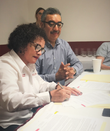 Javier Duran and Maricela Moreno Cano, Director of IMFOCULTA, sign an interorganizational MOU to support artists creating border-related work in the Nogales, Sonora, area